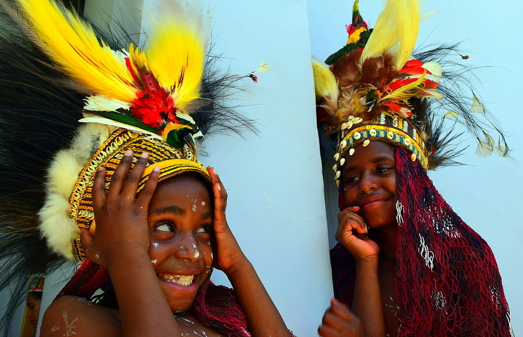 Young Papuan girlwith bird of paradise headdress